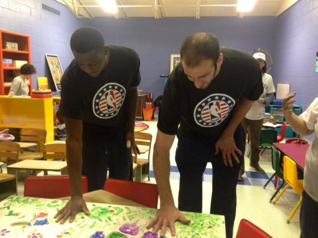 Jordan Adams and Kosta Koufos lend a hand to the  Pre-k room renovation